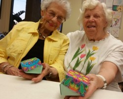 We folded adult coloring book art we did into attractive origami boxes.